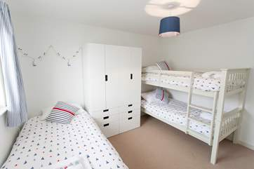 The family bedroom has bunk beds for the younger children and a single bed for the older ones.