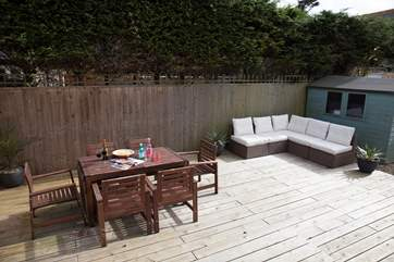 The garden comes equipped with garden furniture and dining seating for those sunny days