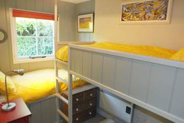 The bunk-room has captain's bunks.