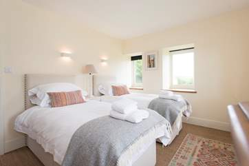 The second bedroom with 'zip and link' 6' double bed, shown made up as twin beds.