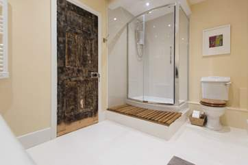 The bathroom has a large walk-in shower as well as the roll-top bath.
