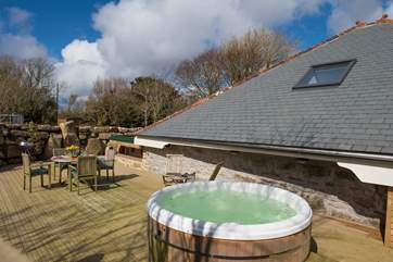 The hot tub and terrrace are to the rear of the cottage, ensuring complete privacy.