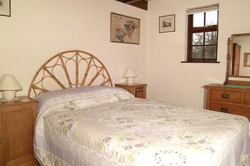 The bedroom where you will find the beds made up for you with sheets and blankets, the old fashioned way.