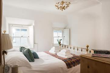 This dual-aspect bedroom with views down to the harbour and a king-size bed is next to the bathroom.