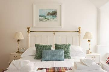 Crisp white linen with colourful cushions and throws and fluffy white towels make for a very comfortable stay.