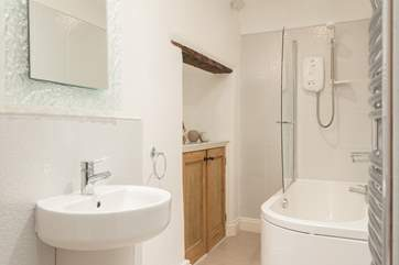 The stylish bathroom is on the first floor.