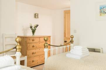 This lovely twin bedroom is a great space for adults and children.