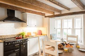 If you like to eat at home, this well-equipped kitchen with large range is a cook's dream.