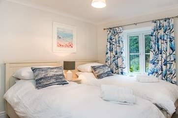 The pretty decor continues in the twin bedroom.
