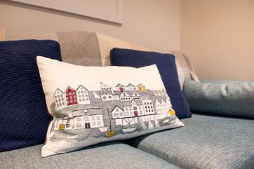 Lots of lovely cushions give the cottage a homely feel.