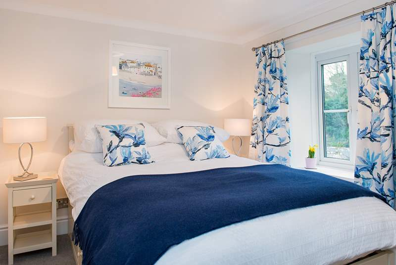 The pretty master bedroom has a comfy 5' double bed.