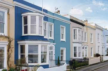 Bussillion is a fabulous early Victorian townhouse, part of an iconic terrace in the heart of Falmouth (the dark blue house).