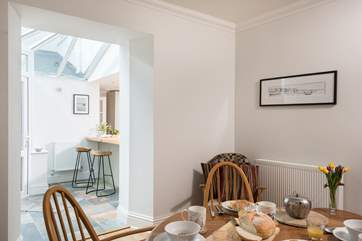 An open archway from the dining-room into the kitchen/breakfast-room.