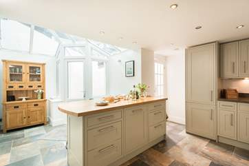 The glazed end of the kitchen/breakfast-room brings in plenty of light.