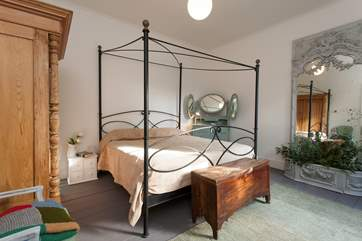 This fantastic bedroom has a four-poster, king-size bed and fantastic mirror piece all the way from France.