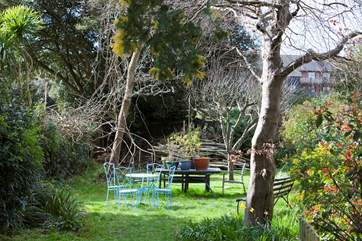 The garden is enclosed and a perfect area for a barbecue.