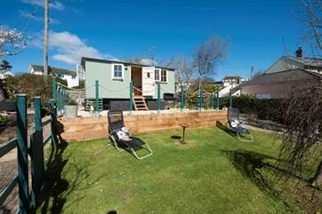 The sheltered lawned area has sun loungers where you can while away the afternoon listening to the waves and bird song.