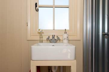 The compact and very cute bathroom is all fully flushing and functional.