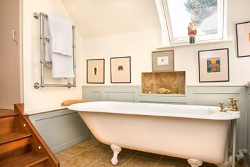 Steps lead down from the twin bedroom into the elegant en suite bathroom.