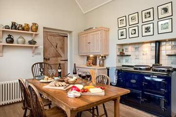 The kitchen has a gorgeous four oven Aga.