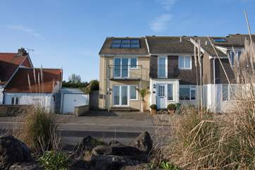 Situated steps away from the beach, Shore House is a stunning three bedroom house right by the sea