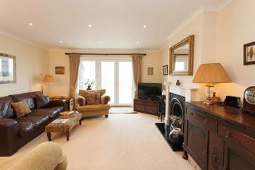 The cosy living room has plenty of comfortable seating and is a lovely space to relax