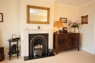 The living room has a lovely ornamental fireplace bringing character to the room