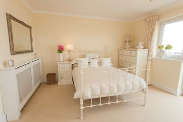 The double bedroom on the first floor has patio doors out to a balcony with stunning views over the solent