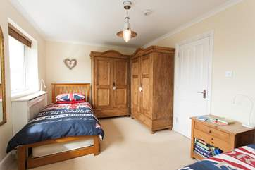 There is plenty of space in the twin bedroom looking out to the back garden and swimming pool