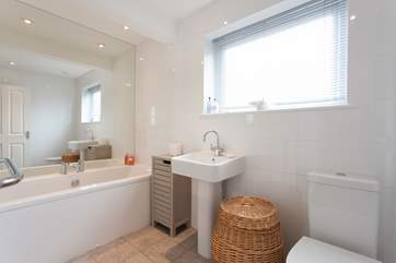 The family bathroom has plenty of room and a lovely bath to soak, relax and unwind