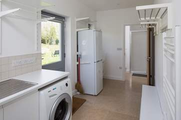 Large utility-room. Perfect for storing all those boots, bags and coats. Leading into a separate WC, with a large shower cubicle.