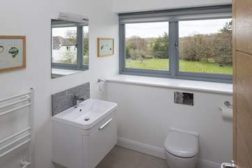 The large family bathroom also offers stunning views.