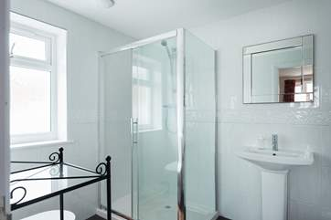 This spacious shower-room is en suite to Bedroom 6.