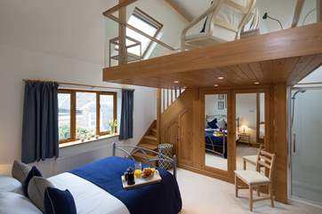 The master bedroom is superb, with its carefully crafted mezzanine, offering that somewhere quiet to escape to read a book or simply enjoy the view in peace.