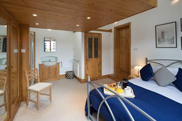 The master bedroom with en suite WC, and a wash-basin and shower cubicle situated in the far left corner of the room.