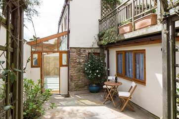 Step off the High Street, down a secret passage and burst through the door into this magical patio belonging to Harmony Cottage. What an exciting way to start your holiday.