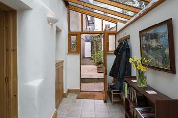 The spacious entrance hall is the perfect spot to dump the boots, bags and coats after a day of exploring. The white door is the access to the passageway out to High Street, this door is access only f