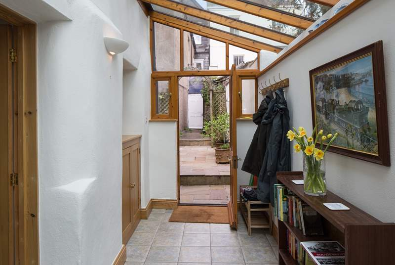 The spacious entrance hall is the perfect spot to dump the boots, bags and coats after a day of exploring. The white door is the access to the passageway out to High Street, this door is access only