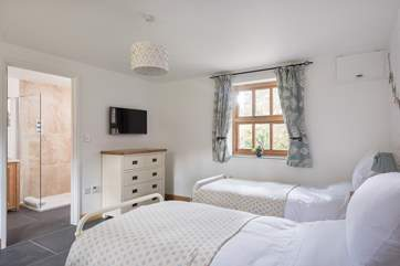 Light floods into the bedrooms with both having dual-aspect windows.