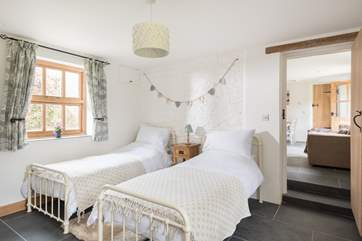A couple of steps lead down to Bedroom 2, at one end of the cottage, with twin beds.