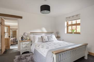 Three steps leads up to the beautiful master bedroom which has the most gorgeous linens and soft furnishings.