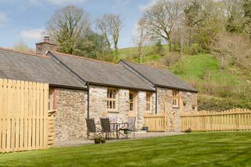This lovely, low single-storey barn nestles in a sheltered valley.