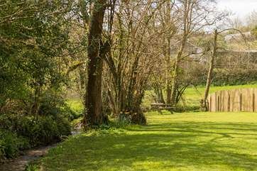 The level lawn adjoins the little stream.