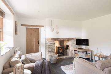 A warming wood-burner for toasting toes on chillier days.