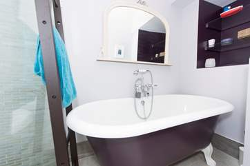 The roll-top bath in the ground floor bathroom. Top quality fluffy towels are provided.