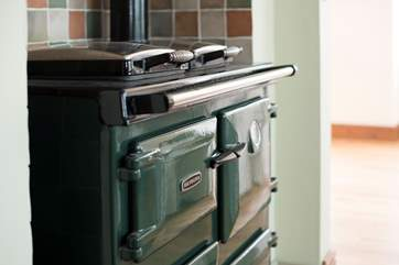 An oil-fired Rayburn provides a constant heat.