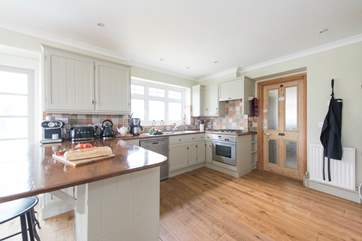 The kitchen-area, with top quality appliances including a Miele oven and Liebherr fridge