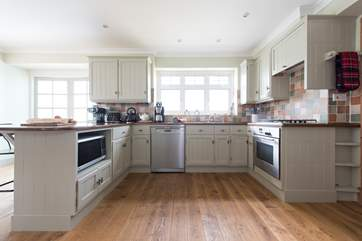 The gorgeous kitchen-area, equipped with a slow cooker, Tefal Optigrill, an Actifry and espresso machine.