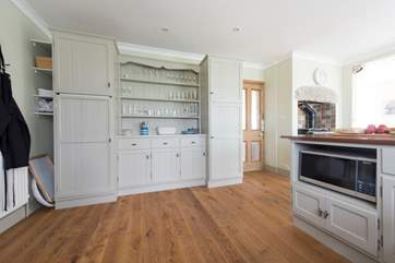 The spacious kitchen is lovely and simplistic.