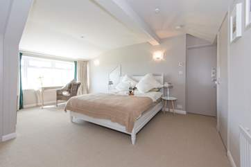 The first floor master bedroom with a top quality feather mattress and bedding.